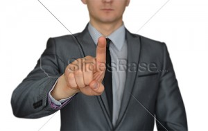 businessman-suit-pointing-finger-at-screen-touchscreen-stock-photo