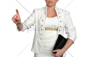 businesswoman-pointing-at-touchscreen-white-clothes-stock-photo