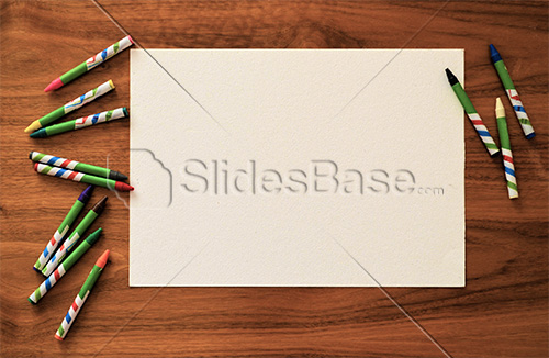 crayons-and-paper-drawing-art-wooden-desk-stock-photo