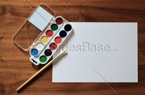 watercolors-painting-paper-on-desk-stock-slidesbase