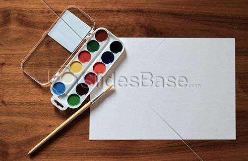 watercolors-painting-paper-on-desk-stock-slidesbase
